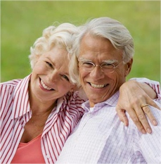 two smiling elderly people